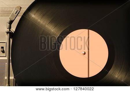 Old vinyl black phonograph record close up