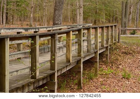 Old Wooden Bridge over dry stream bed