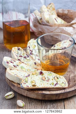 Cranberry and pistachio biscotti with vin santo wine