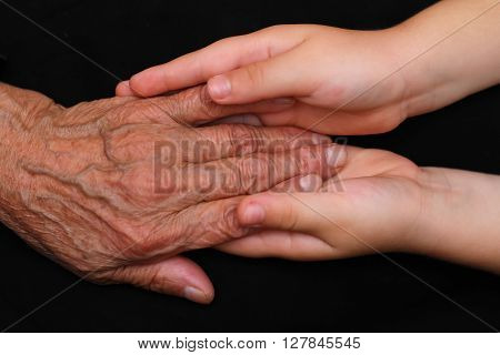 Young hands tending to an elderly person
