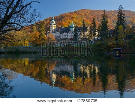 Northern front of Lillafured palace (Miskolc Hungary). Lake Hamori in foreground mountains covered with multicolored forest in background.