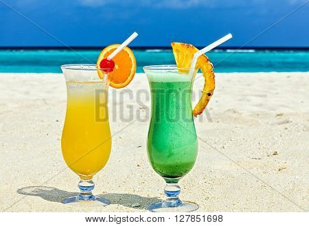Two glasses of cool drink are on the beach Maldives The Indian Ocean