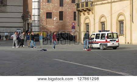 SIENA ITALY - CIRCA APRIL 2016: Polizia muncipale (i.e. Town Police) seizing football ball of Italian schoolboys playing in the Cathedral square