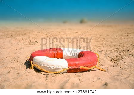 Lifebuoy On Sandy Beach. Security at the sea