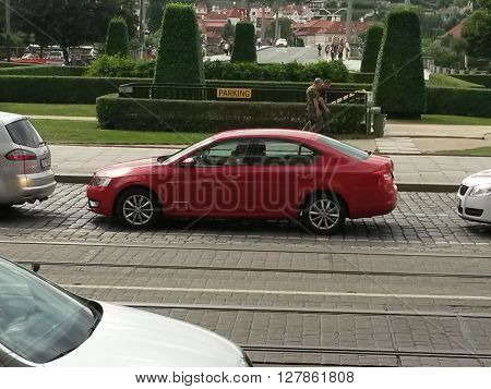 PRAGUE CZECH REPUBLIC - CIRCA JUNE 2015: red Skoda Octavia in a street of the city centre