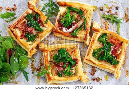 Bacon, soft cheese and tenderstem broccoli tips puff pastry tarts with green salad.