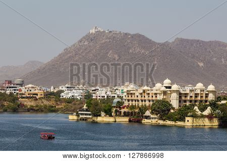UDAIPUR INDIA - 21ST MARCH 2016: A view towards the The Leela Palace and Monsoon Palace in Udaipur during the day.