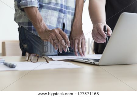 Men Working With Business Document And Computer Notebook