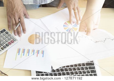 Men Working With Calculator, Business Document And Computer Notebook, Vintage Tone
