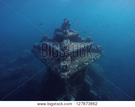 Underwater temple near the coral reef in the deep blue sea, snokeling in Bali, underwater finding, underwater temple for divers, diving in Bali, blue sea of Amed, vacation in Bali island, Indonesia