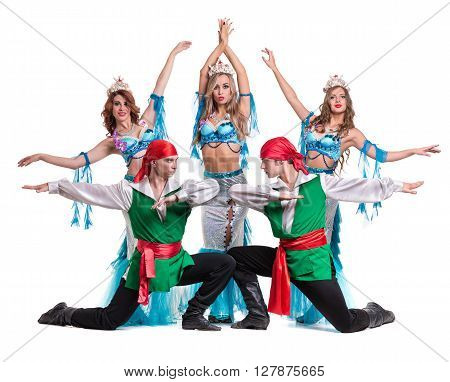 Carnival dancer team dressed as mermaids and pirates. Retro fashion style, isolated on white background in full length.