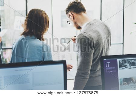Business meeting photo.Manager crew working with new startup project, discuss statistics reports.Idea presentation, analyze marketing plans.Blurred background, film effect.