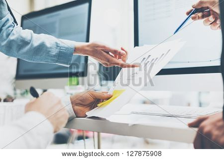 Business meeting office, closeup photo documents holding hands. Photo account managers crew working with new startup project.Idea presentation, analyze marketing plans.Blurred, film effect