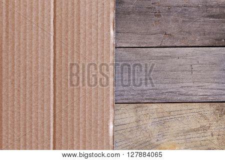 Paperboard on wooden and paper planks in close-up.