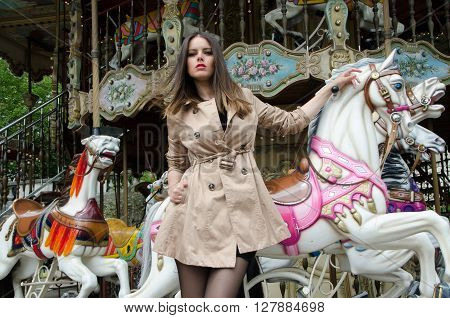 Sexy woman portrait with coat in Carrousel in Paris