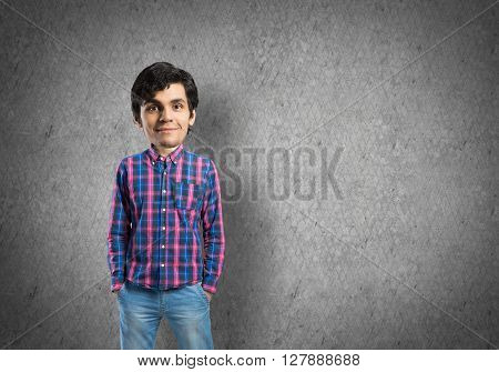 Funny young bigheaded man in casual with hands in pockets