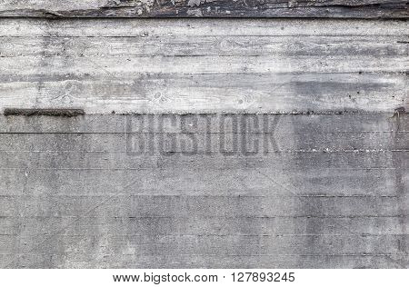 Old grunge concrete wall background texture with drainage holes and moisture stains with discoloration full frame view