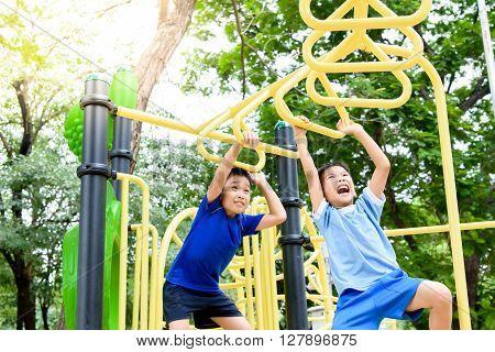 Boy Play With Hang Yellow Bar.