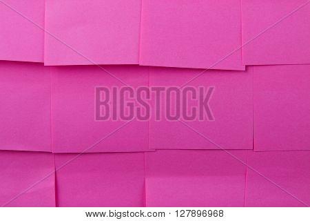 Sticky notes. Background of a pink sticky notes