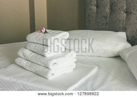 White Bed Sheets With Brown Bed In Hotel Room