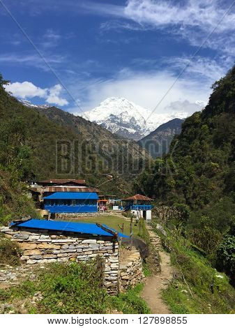 Trekking path to Everest, small village in the mountains, blue roof of rustic house in mountains, peaceful mountain landscape, summer mountain landscape with village, mountain village, Himalaya, Nepal