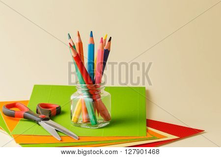 Various School And Art Supplies Laid On Table
