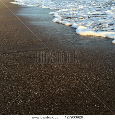 Wave and beach, shiny tropic sea wave on the beach sand in sunset light, summer holiday, beach life, white foam wave and yellow sand, close up of beach and sea wave, beach holiday, quiet sea, Bali