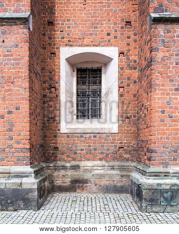 Old windows in red brick wall church or cathedral.