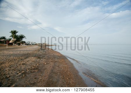 landscape shore of Egyptian sand beach in Red Sea seaside blue ocean water and horizon sky in El Gouna Hurghada Egypt Africa