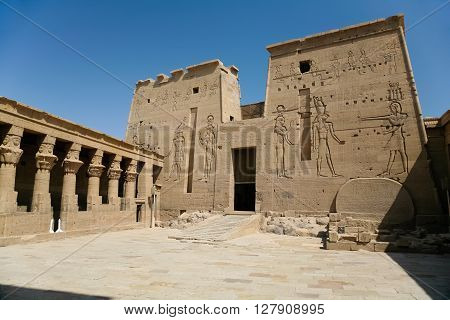 stone carved colonnade and facade door of landmark interior Temple for the goddess Isis Egyptian public monument declared World Heritage Unesco in Philae Egypt Africa