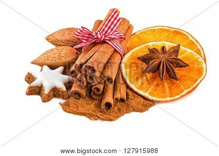 Christmas spice decoration with cinnamon anise almond nuts and orange slices.
