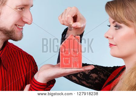 Couple With Little House And Silver Coin.