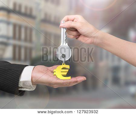 Woman Hand Giving Key Euro Sign Keyring To Man Hand