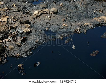 Toxic household garbage and hazardous industrial waste contaminates water and land at the largest and most heavily polluted landfill site in Bali Indonesia.