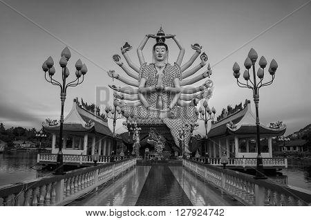 Buddhist pagoda at sunset. Temple complex Wat Plai Laem on Samui island. Thailand, Koh Samui. Black and white