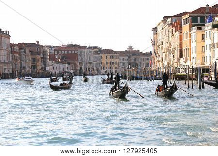 Boats And Gondolas With Many Tourists Sailing On The Grand Canal