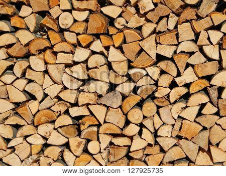 Logs And Timbers Of A Woodpile In The Woodshed