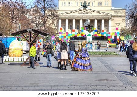 MOSCOW RUSSIA - April 24.2016: Artists in ball gowns offer tourists to take a photo
