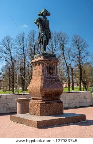 Gatchina, Russia - May 1, 2016: Monument to Paul I in front of the Gatchina Palace. Paul I - Emperor and Autocrat of all the Russias 1796 - 1801. Behind the monument are the sundial.