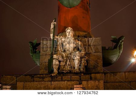 St. Petersburg. South rostral column. The male figure allegorically represents the Dnieper River. Night Photography. Earlier rostral column represented the Navy and served as a beacon of glory.