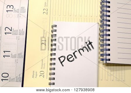 Permit text concept write on notebook .