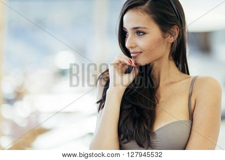 Beautiful indian looking girl posing in bikini in summer