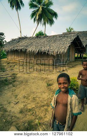 Smiling Boys Near House