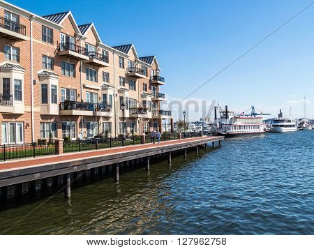 BALTIMORE-APRIL 23 - Luxury waterfront townhouses along the Baltimore Waterfront Promenade on April 23 2016 in Baltimore Maryland.
