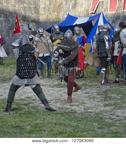Pisa, Italy - March 26, 2016: Sword fight between knights in historical re-enactment