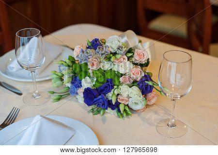 beautiful wedding boquet lying on table in restaurant.