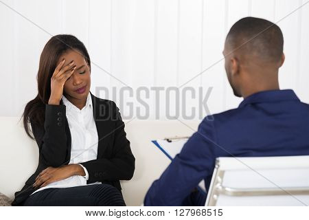 Depressed African American Woman At Psychiatrist Appointment
