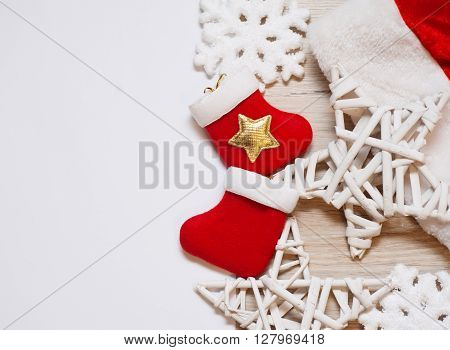 Two christmas stockings with wooden stars and place for text.