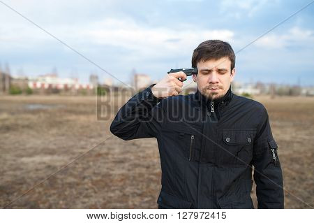 Man trying to commit suicide with a gun