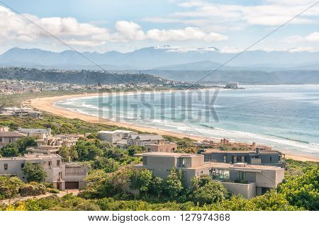 PLETTENBERG BAY SOUTH AFRICA - MARCH 3 2016: View from the entrance to Robberg Nature Reserve of a beach and houses with the hotel on Beacon Island in the back